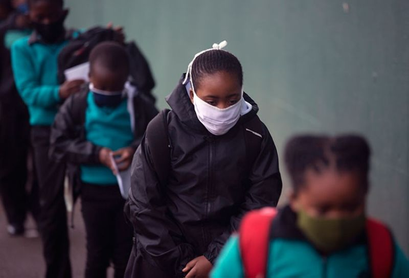 SOUTH AFRICA. Learners queue to go through their regular morning checks on their arrival at the Melpark Primary School in Johannesburg, Thursday, September 3, 2020. (AP)