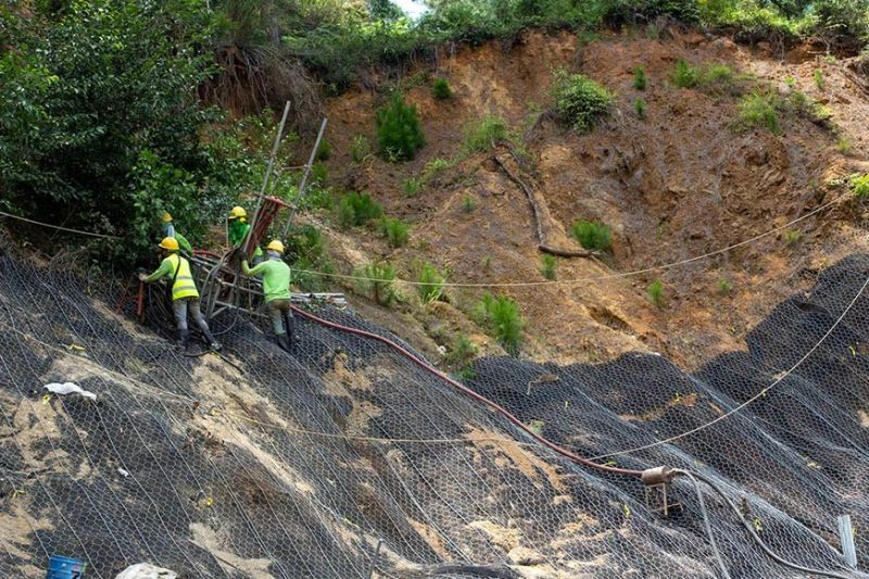 LANDSLIDE PREVENTION. Workers lay improvements at a landslide-prone area near the Loakan Airport. Almost two years ago, a major landslide occurred in the area when Typhoon Ompong hit the country. (Jean Nicole Cortes)