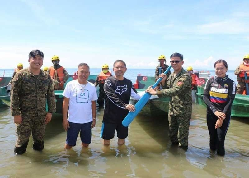 ZAMBOANGA. The Provincial Government of Zamboanga del Sur has acquired motorboats to boost the province's coastal security. A photo handout shows Zamboanga del Governor Victor Yu (3rd from left) turns over Sunday, September 13, in Tukuran town a paddle to Lieutenant Colonel Jo-ar Herrera, commander of the 53rd Infantry Battalion. (SunStar Zamboanga)