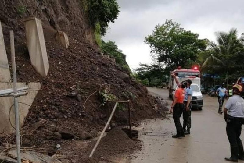 TEMPORARILY OFF-LIMITS. Officials of Talisay City's Local Disaster Risk Reduction and Management Office and local police inspect a minor landslide on the Talisay-Uling Access Road in Barangay Manipis following the downpour on Wednesday, Sept. 16, 2020. Due to fears that more landslide will occur, Mayor Gerald Anthony Gullas Jr. has prohibited joggers, cyclists, sightseers and mobile vendors from passing the area until Sunday, Sept. 20. (Contributed photo)