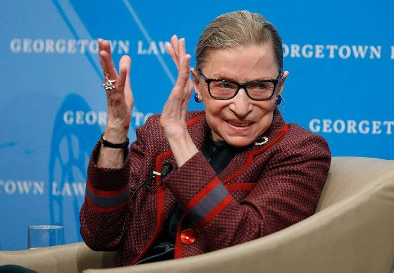 USA. In this April 6, 2018, file photo, Supreme Court Justice Ruth Bader Ginsburg applauds after a performance in her honor after she spoke about her life and work during a discussion at Georgetown Law School in Washington. (AP)