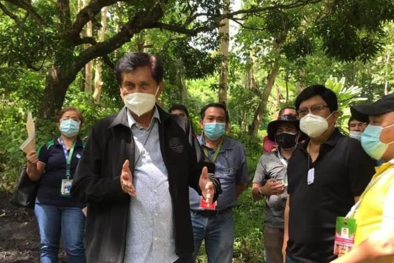 INSPECTION. On July 20, 2020, Environment Secretary Roy Cimatu (left), Cebu City Mayor Edgardo Labella (right) and other officials went to Barangay Sapangdaku to inspect the site of the proposed two-hectare cemetery for city residents who succumbed to the novel coronavirus. (CONTRIBUTED  DENR 7)