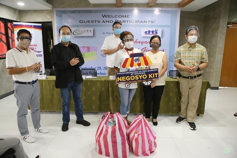SUSTAINABLE LIVELIHOOD. One of the 10 Aeta beneficiaries of the Department of Trade and Industry and Clark Development Corporation livelihood program receives a Soap Making Negosyo Kit during a simple ceremony held at the Clark Skills and Training Center. (CDC-CD)