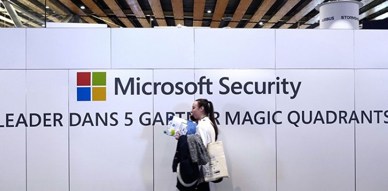 A woman walks in front of the Microsoft stand during the Cybersecurity Conference in Lille, northern France, Wednesday Jan. 29, 2020. Microsoft announced legal action Monday, Oct. 12, 2020 seeking to disrupt a major cybercrime digital network that uses more than 1 million zombie computers to loot bank accounts and spread ransomware, which experts consider a major threat to the U.S. presidential election. (AP file photo)