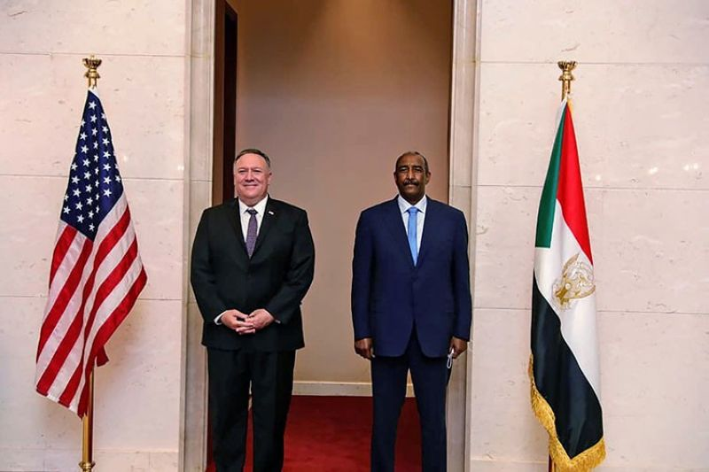 In this Aug. 25, 2020 file photo, U.S. Secretary of State Mike Pompeo stands with Sudanese Gen. Abdel-Fattah Burhan, the head of the ruling sovereign council, in Khartoum, Sudan. President Donald Trump on Monday, Oct. 19, 2020 said Sudan will be removed from the U.S. list of state sponsors of terrorism if it follows through on its pledge to pay $335 million to American terror victims and families. (AP file photo)