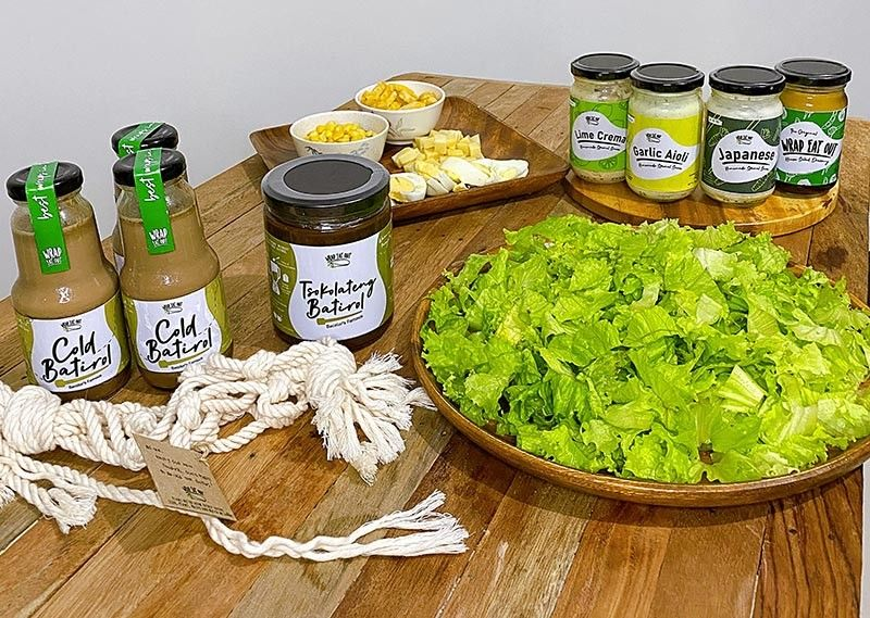 Create your salad with Wrap Eat Out's homemade salad dressings, or enjoy their cold bottled batirol