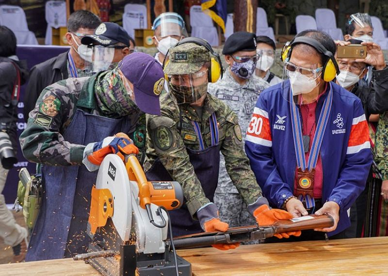 DESTROYED. Secretary Carlito Galvez Jr. leads the ceremonial destruction of surrendered firearms under the normalization program for the Cordillera Peoples Liberation Army on Friday, October 23, at Camp Bado Dangwa in La Trinidad, Benguet. (Jean Nicole Cortes)