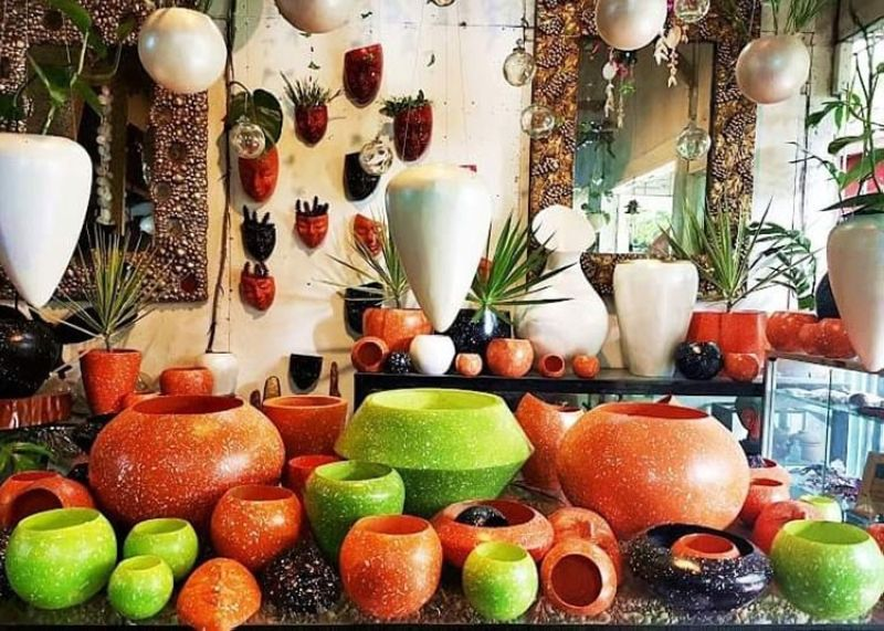 BACOLOD. Jojo Vito's orange and green collection mixed with black and white pots. (Contributed photo)