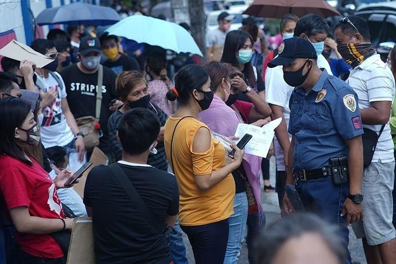 DAVAO. In this photo taken in June 2020, people line up to secure a travel authority. (SunStar Davao File)