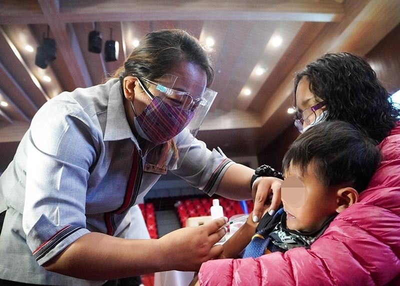 END POLIO. After receiving the oral polio vaccine, a child gets injected with measles, mumps and rubella (MMR) vaccine on October 26.  Baguio City has institutionalized the World Polio Day Celebration every October 24. (Photo by Jean Nicole Cortes)