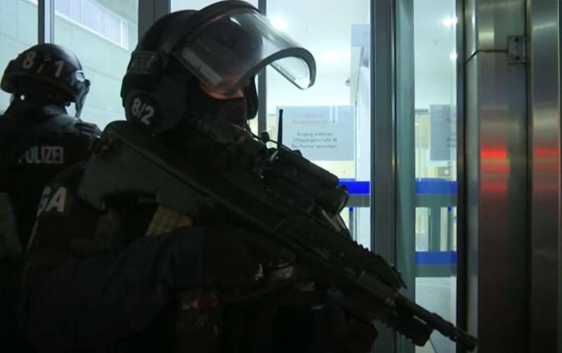 In this image made from video, police at the scene after gunshots were heard, in Vienna, Monday, Nov. 2, 2020. Austrian police say several people have been injured and officers are out in force following gunfire in the capital Vienna. Initial reports that a synagogue was the target of an attack couldn't immediately be confirmed. Austrian news agency APA quoted the country's Interior Ministry saying one attacker has been killed and another could be on the run. (AP Photo)