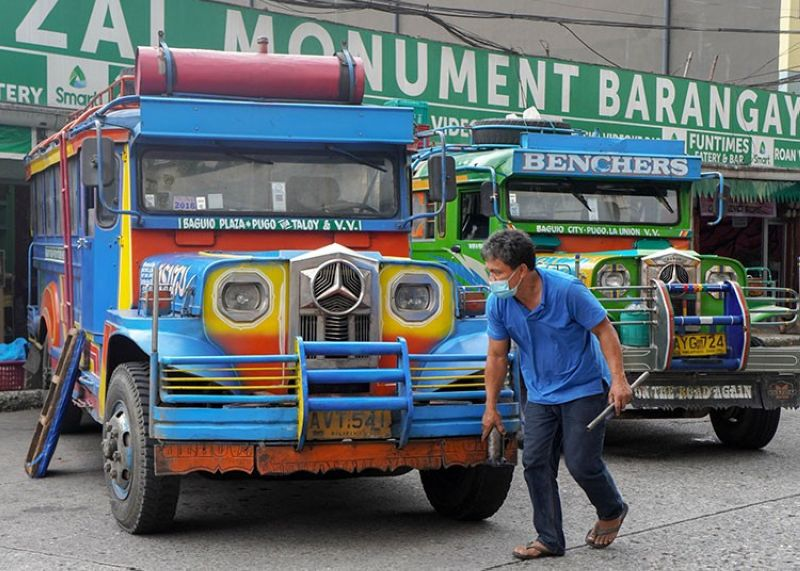 PUBLIC TRANSPORT. A jeepney driver makes necessary repairs on his vehicle while coping with the Covid-19 pandemic. Jeepney operators are only allowed to operate within 50 percent of the unit's carrying capacity while maintaining regular fare rate. (Jean Nicole Cortes)