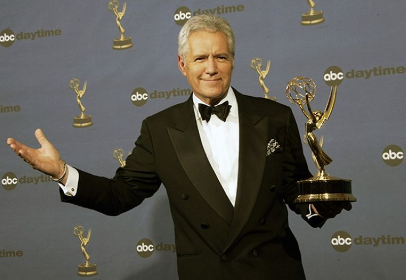 In this Friday, April 28, 2006, file photo, Alex Trebek holds the award for outstanding game show host, for his work on