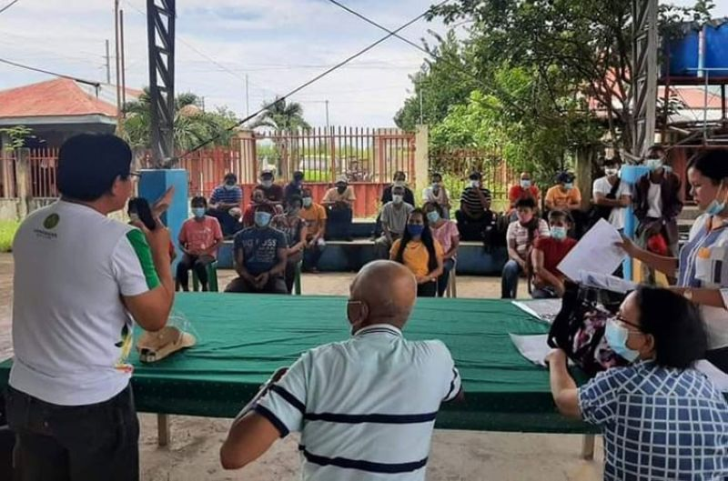 NEGROS. Farmer-beneficiaries in Barangay Palayog in Hinigaran town receive their land titles in a distribution rites held in the village on November 12, 2020. (Contributed photo)