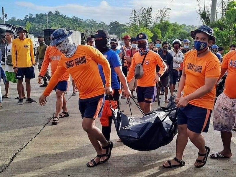 CAGAYAN. Philippine Coast Guard (PCG) personnel recover two fatalities in Barangay Pared, Alcala, Cagayan. (PCG)