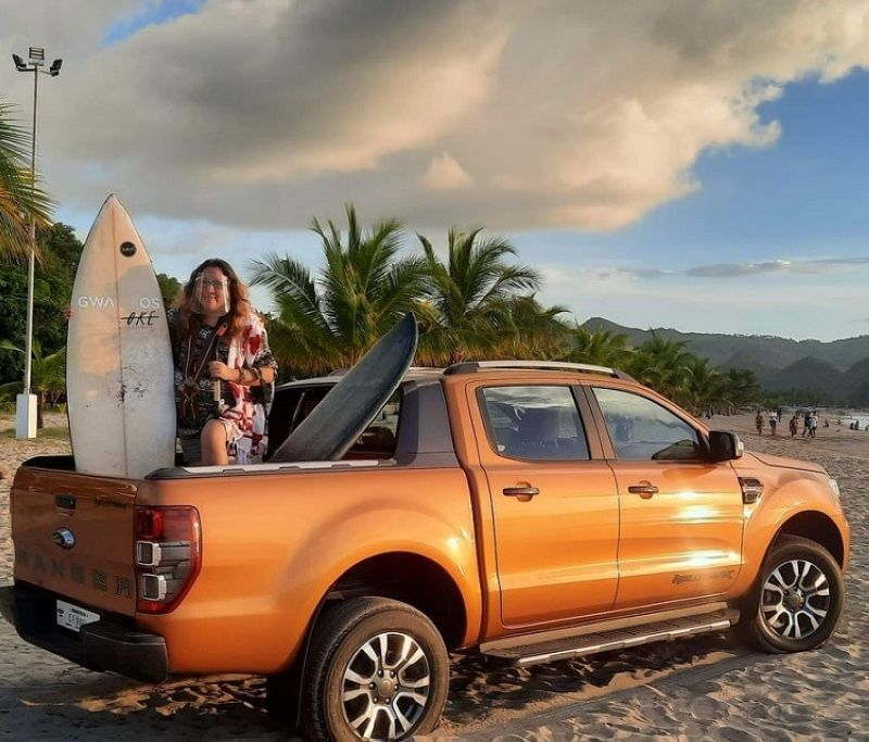 FORD RANGER. Jocelle catches the sunset atop the Ford Ranger Wildtrak in Sipalay, Negros Occidental, home to various beach activities like surfing when the waves are high. (Photo by Jocelle Batapa Sigue)