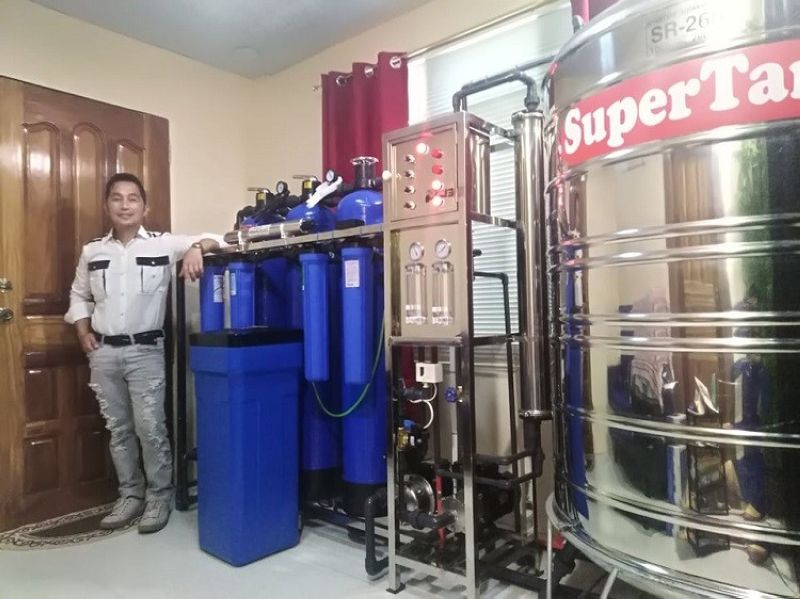 OFW Rolly Real with his water facilities and equipment. (Contributed photo)
