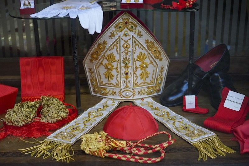 ROME. Cardinal clothing accessories are seen on display in the window of the Gammarelli clerical clothing shop, in Rome, Thursday, Nov. 26, 2020. (AP)