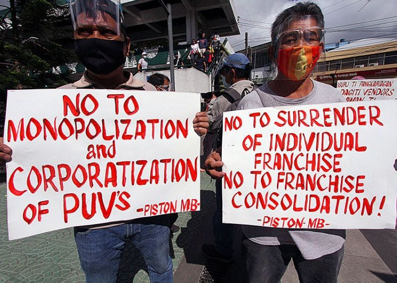 CORPORATE TAKE OVER. Piston members in Baguio City march to air their sentiments against the jeepney modernization, saying it will affect their livelihood and the riding public due to the cost of modernized jeeps. (JJ Landingin)