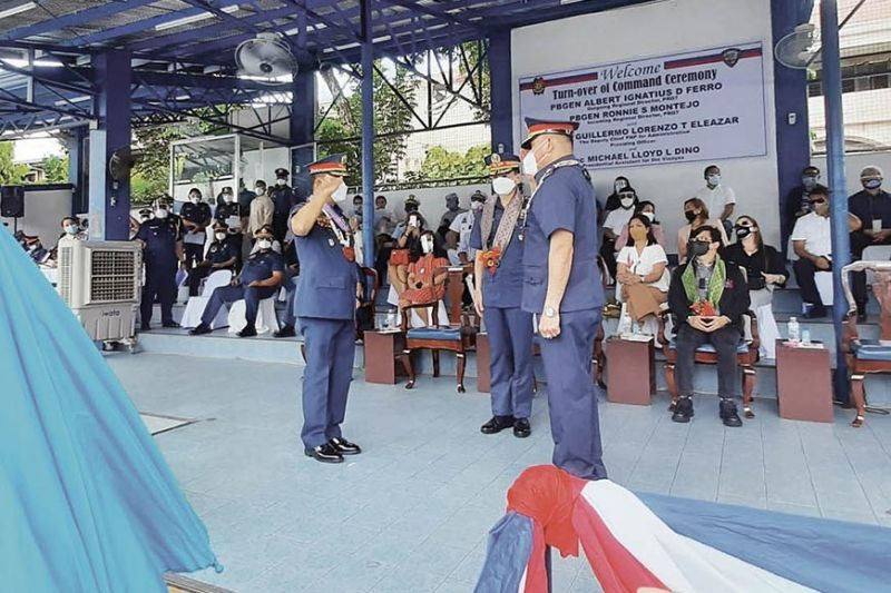 FERRO'S FAREWELL. Brig. Gen. Albert Ignatius Ferro (left) and Brig. Gen. Ronnie Montejo (right) salute one another during the turnover ceremony at the Police Regional Office (PRO) 7 headquarters in Cebu City on Tuesday, Dec. 1, 2020. Montejo is the new PRO 7 chief, replacing Ferro who is now the chief of the Directorate for Information and Communication Technology Management.  (ARNOLD BUSTAMANTE)