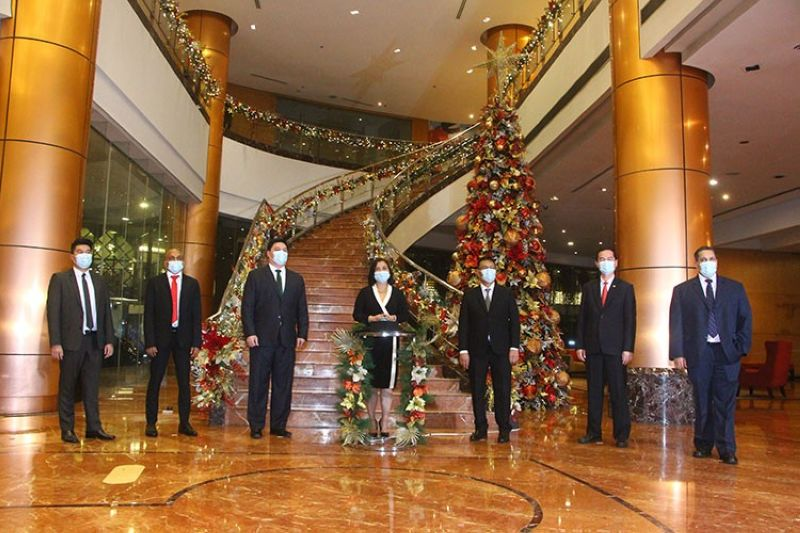 Megaworld Hotels executive and general managers at the symbolic tree Lighting at Eastwood Richmonde Hotel (from left): Jeremy Go, Hotel Lucky Chinatown resident manager; Joe Fijardo, Kingsford Hotel Manila general manager; Jorold Montelibano, Richmonde Hotel Ortigas general manager; Cleofe Albiso, Megaworld Hotels Group general manager; Jun Justo, Eastwood Richmonde Hotel general manager; Oliver Esguerra, Twin Lakes Hotel Tagaytay general manager; Avinash Menon, Belmont Hotel Manila and Savoy Hotel Manila area general manager