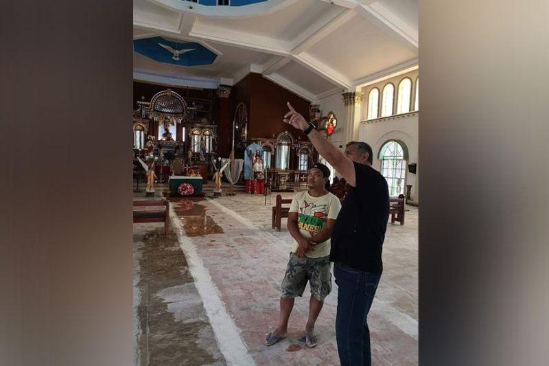 CHURCH RENOVATION. Mayor Danilo Guintu checks the improvement in the renovation of St. Michael the Archangel Parish Church. (Princess Clea Arcellaz)