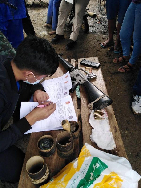 CAGAYAN. A policeman lists the firearms and explosives allegedly found in the house of Amanda Echanis. (From PNP)