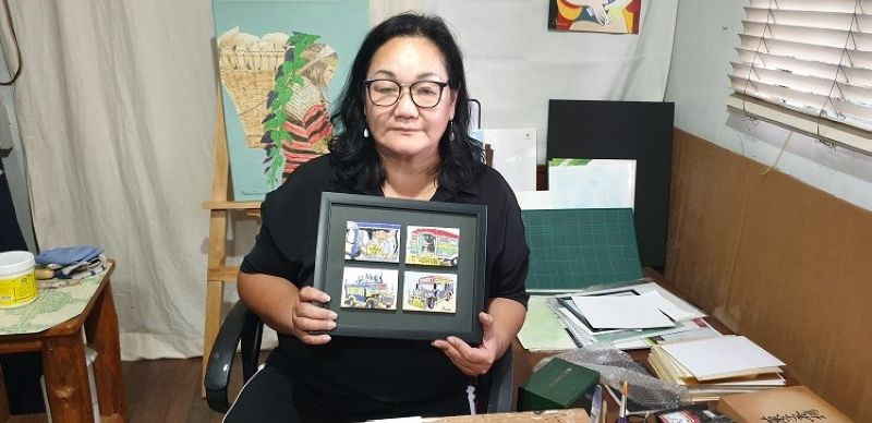 THE ARTIST. The artist at her home, doing her jeepney art cards as a homage to the iconic Philippine mode of transportation now facing phase-out. (Photo by Maria Elena Catajan)