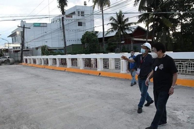 BACOLOD. Mayor Evelio Leonardia and City Engineer Aladino Agbones inspect the newly replaced and widened bridge on Lacson Street Extension in October. The mayor will inaugurate the project Tuesday, December 8, 2020. (PR)