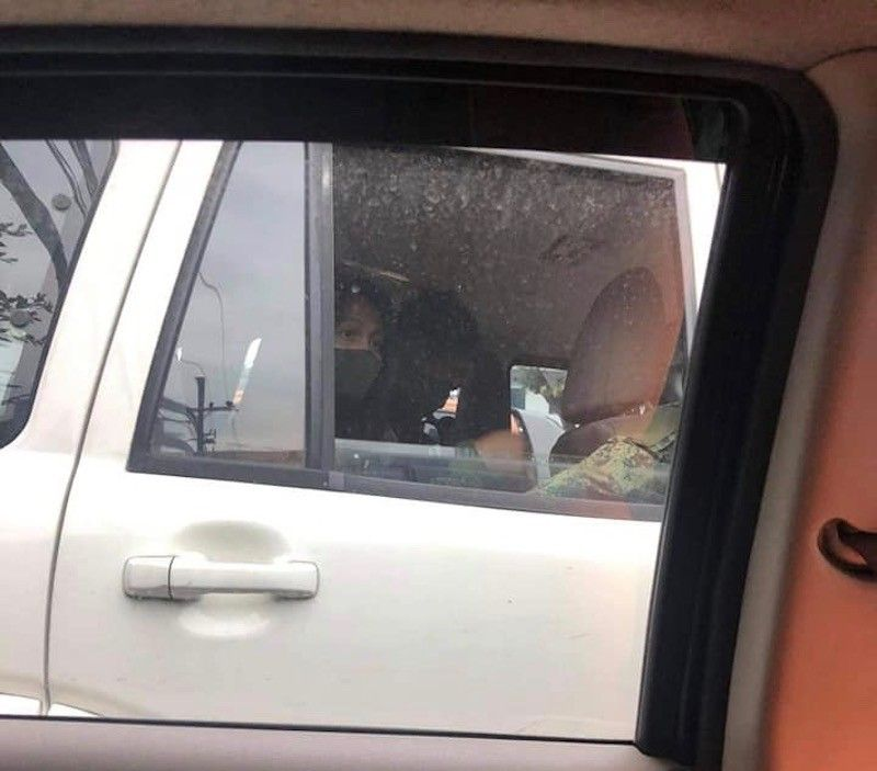 MANILA. Lady Ann Salem is shown in an unmarked vehicle after she was taken from her home on December 10, 2020. She is under CIDG custody. (From NUJP)
