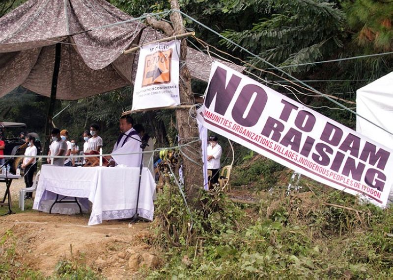 OPPOSED. Residents from Barangays Poblacion, Dalupirip, and Tinongdan in Itogon, Benguet join the ecumenical mass near the opposed Tailings Storage Facility Dam 2 of Benguet Corporation. These lower downstream communities opposed the plans of the mining firm to raise the level of the dam. (Lauren Alimondo)