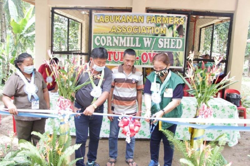ZAMBOANGA. The Department of Agriculture-Special Area for Agricultural Development (DA-Saad) program releases some P1.2 worth of agricultural interventions Friday, December 11, 2020, to an association of farmers in Kalawit, Zamboanga del Norte. A photo handout shows municipal and agriculture officials inaugurating the cornmill with a shed given to the farmers. (SunStar Zamboanga)