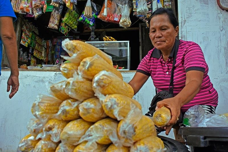"""STRUGGLING. One of the severely-affected economically by the quarantines brought about by the Covid-19 pandemic are those who belong to the """"informal economy"""" sector such as the street vendors and trisikad/tricycle drivers. (Photo by Mark Perandos)"""