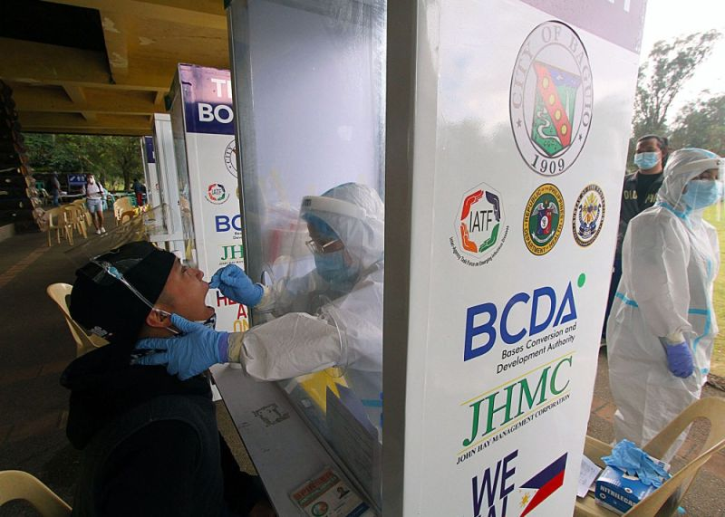 BAGUIO. Anybody needing to have themselves tested for the novel coronavirus can avail of the free testing at Melvin Jones Grandstand until Friday, December 18, 2020. The BCDA Philippine Arena team with the Bureau of Fire Protection are now conducting free swab testing for anyone near Burnham Park. One only needs to present a valid identification card, fill out a form, fall in line and, in less than two minutes, the test is over. (Photo by JJ Landingin)