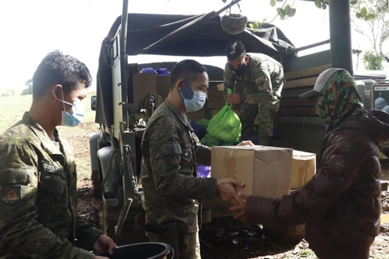 ZAMBOANGA. The Army's 82nd Infantry Battalion has distributed boxes of goodies to former members of the ISIS-inspired Dawlah Islamiya to convey to active members of the group that the government is open to accepting anyone who wants to surrender and give way to peace. A photo handout shows one of the beneficiaries (right) receiving a box of goodies that include hygiene kits. (SunStar Zamboanga)
