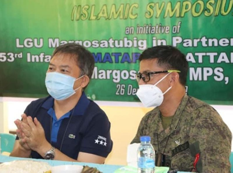 ZAMBOANGA. The Municipal Government of Margosatubig, Zamboanga del Sur, together with the 53rd Infantry Battalion (IB) and Margosatubig police, holds a Peace Building Forum and Islamic Symposium on December 26 to empower the tri-people in the town. A photo handout shows Zamboanga del Sur Governor Victor Yu (left) and Lieutenant Colonel Jo-ar Herrera, 53IB commander (right), listen attentively to one of the resource speakers of the activity. (SunStar Zamboanga)