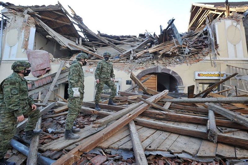 CROATIA. Soldiers inspect the remains of a building damaged in an earthquake in Petrinja, Croatia, Tuesday, December 29, 2020. (AP)