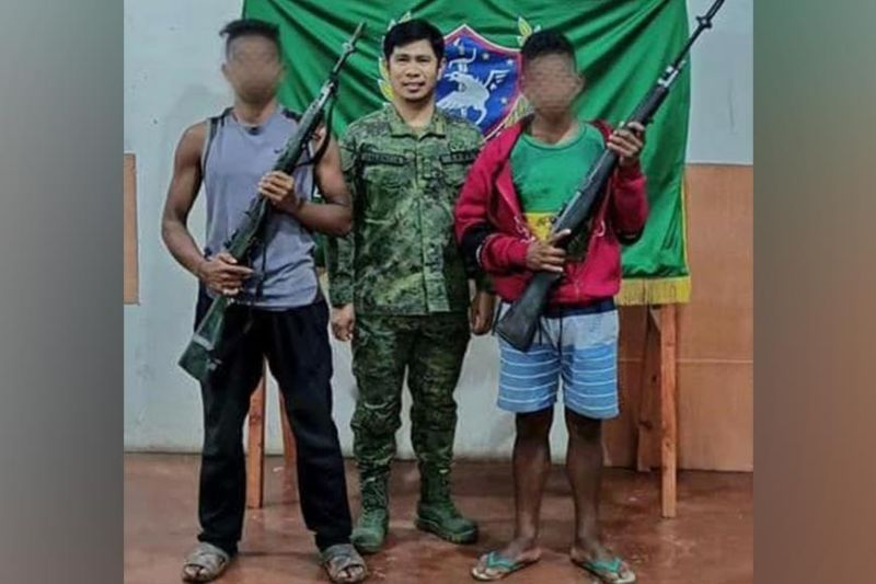 ZAMBOANGA. Two communist New People's Army (NPA) terrorists surrender Friday, January 1, due to by pressures of continued military offensive against them in Sultan Kudarat province. A photo handout shows the two NPA surrenderers together with Lieutenant Colonel Romel Valencia, 7th Infantry Battalion commander. (SunStar Zamboanga)