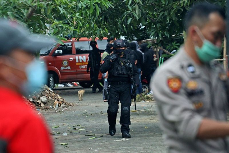 INDONESIA. Police officers walk outside the site where two suspected terrorists were killed during a raid in Makassar, South Sulawesi, Indonesia, Wednesday, January 6, 2021. (AP)