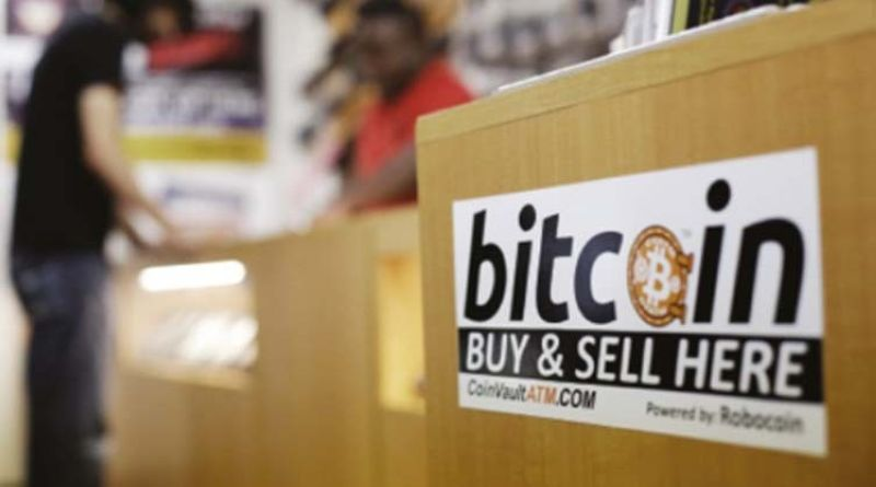 HUGE RALLY. Jon Rumion, background left, talks with Michael Cargill at Central Texas Gun Works in Austin, Texas. Bitcoin has crossed the $40,000 mark, extending on a huge rally that started three months ago, Thursday, Jan. 7, 2021. / AP