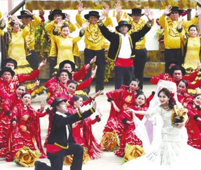 SINULOG AT THE CAPITOL. In this January 2012 file foto, Cebu Gov. Gwendolyn Garcia, dressed as a Spanish señorita by designer Cary Santiago, performs with the La Torta Festival dancers from Argao, during the 2012 Sinulog Festival. Despite no Sinulog this year due to the Covid-19 pandemic, Garcia will still dance at the Cebu Provincial Capitol on Jan. 17, 2021 as an offering to the Snr. Sto. Niño for blessings she has received since last year, including two acquittals from controversial cases against her. / SunStar File