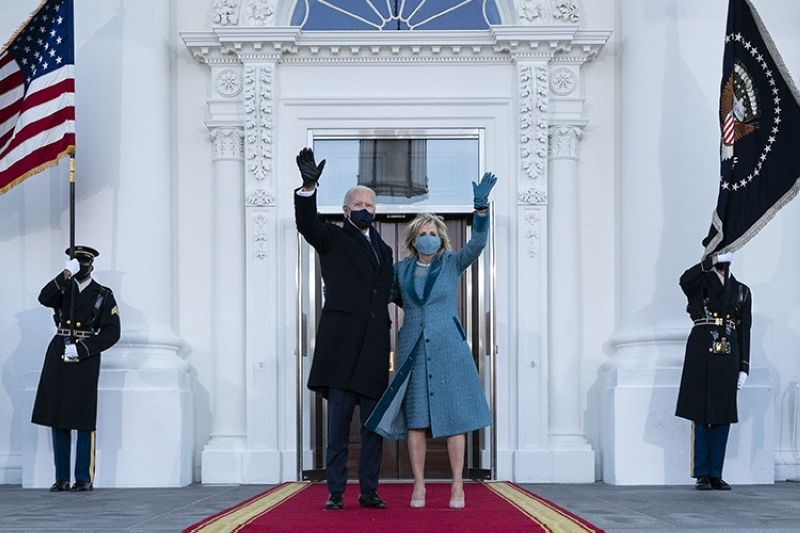 President Joe Biden and first lady Jill Biden wave as they arrive at the North Portico of the White House, Wednesday, Jan. 20, 2021, in Washington. (AP Photo)