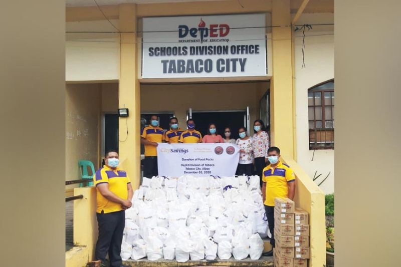 SCHOOL AID. The employees of City Savings Bank deliver relief goods to the Schools Division Office in Tabaco City, Albay on Dec. 3, 2020. Albay was one of the provinces in Luzon battered by a series of typhoons that hit the country in the latter part of 2020. / CONTRIBUTED