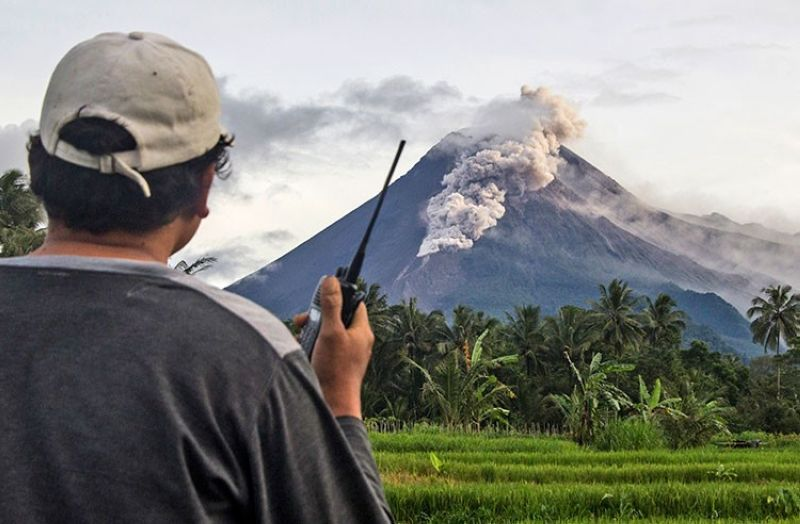 INDONESIA. A volunteer uses his walkie talkie as he monitors Mount Merapi during an eruption in Sleman, Wednesday, January 27, 2021. (AP)