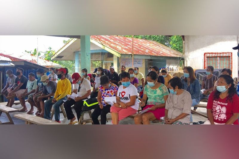 MURCIA. Some of the farmer-recipients during the second batch of evaluation and registration for the government's food and financial assistance program in Barangay Canlandog in Murcia town recently. (Contributed photo)