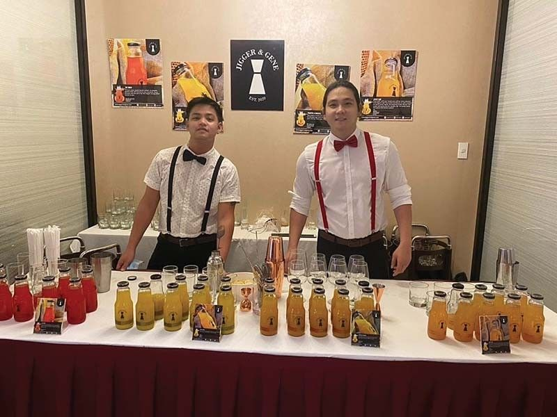 JIGGER AND GENE. Head of operations Joshua Dane Bihag (left) and chief executive officer Eugene Dy shake things up at a wedding reception with their signature drinks.
