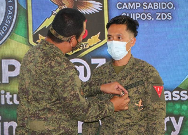 ZAMBOANGA. The Army's 1st Infantry Division (ID) bestows medal to deserving troops of the 53rd Infantry Battalion. A photo handout shows Major General Generoso Ponio, 1ID commander, pins Gold Cross Medal, the fourth highest military award, to one of the awardees, Corporal Fritz Floyed Prejoles, for gallantry in action. (SunStar Zamboanga)