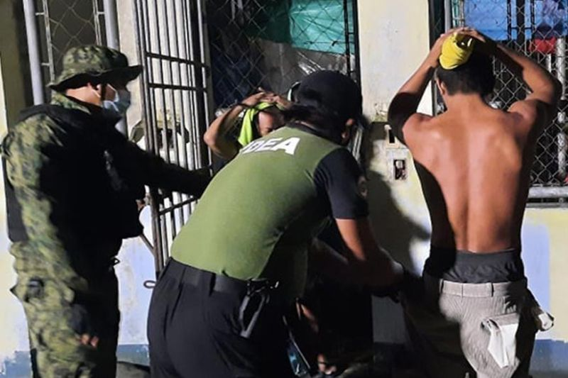 ZAMBOANGA. An agent of the Philippine Drug Enforcement Agency (PDEA), assisted by a policeman, conducts a body search on an inmate during a surprise drugs and weapons sweep Wednesday, February 3, 2021 at the Zamboanga del Norte Correctional and Rehabilitation Center. (SunStar Zamboanga)