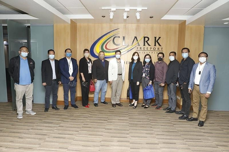 CDC PREXY MEETS CILA BOARD. Clark Development Corporation (CDC) President and CEO Manuel R. Gaerlan (6th from left) recently received the Clark Investors and Locators Association (Cila) led by Jeannie D. Ng (7th from left). In photo are (L to R) CDC Chief of Staff Dennis Legaspi, lawyer Gerald Medina, Pepito Zabat III, Evelyn Yumul, Frankie Villanueva, Froilanda Rodriguez, Joselito Mercado, Christopher Magdangal, Maximo Gulmayo, Jr., and Radito Tuazon. Cila Chairman Irineo 'Bong' Alvaro, Jr. (not in photo) also joined the meeting. (CDC-CD)