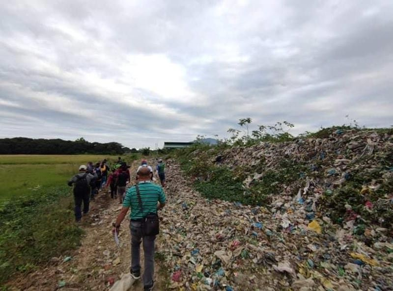 PAMPANGA. Personnel from DENR and PNP Maritime Group inspecting an open dumpsite in Santa Ana town, which was later closed down for violations of environmental laws. (DENR photo)